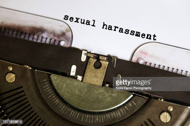 sexual harassment typed on vintage typewriter - anti bullying symbols stock pictures, royalty-free photos & images