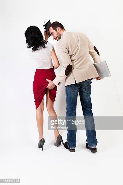 sexual harassment. woman hitting the aggresor  with her agenda - rear end stock photos and pictures