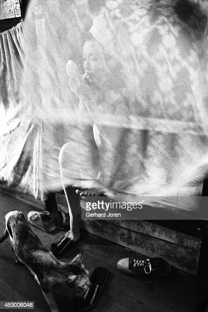 A sexworker in a Manila brothel puts on her makeup in her bunkbed in the late afternoon She usually takes over an hour to get fully madeup 50 women...