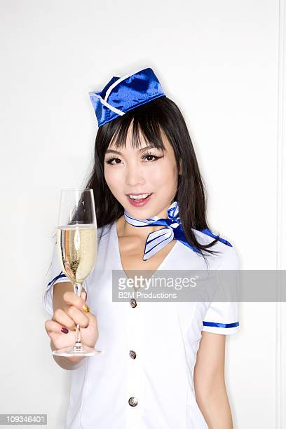 Sexy Airline stewardess with glass of champagne