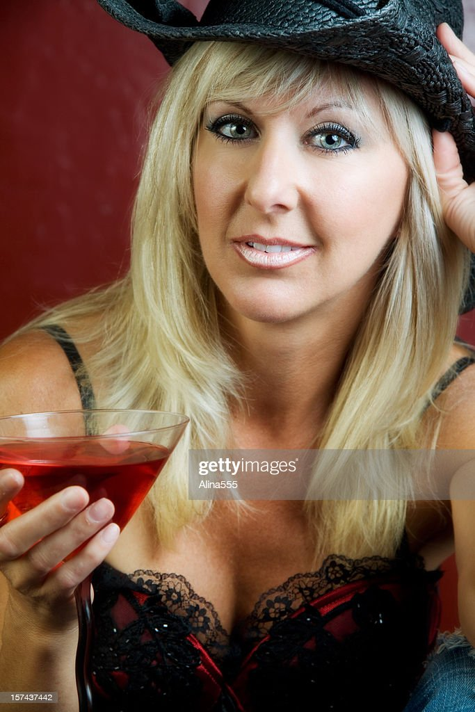 sexy and beautiful mature woman with a martini stock photo | getty