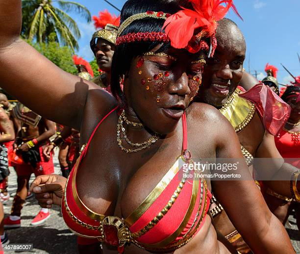 A sexy Bajan girl dancing in the street during the Crop Over festival in Bridgetown Barbados 5th August 2013