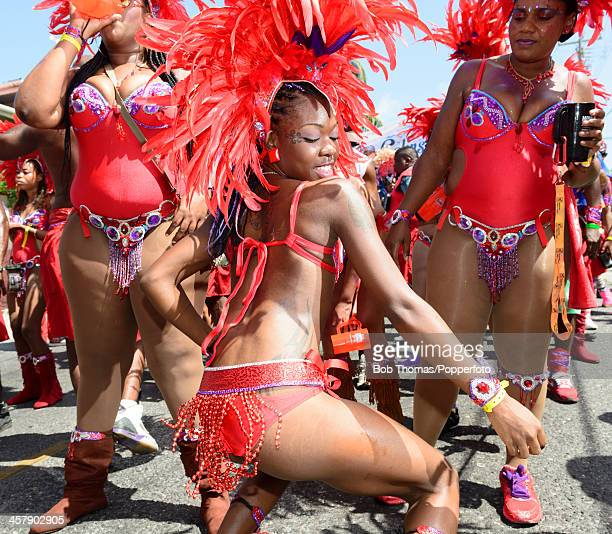 Sexy Bajan girls dancing in the street during the Crop Over festival in Bridgetown Barbados 5th August 2013