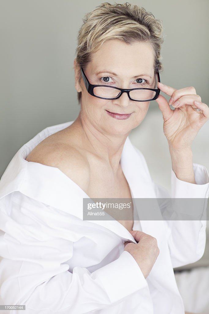 Sexy Beautiful 50year Old Woman On A Bed Stock Photo - Getty