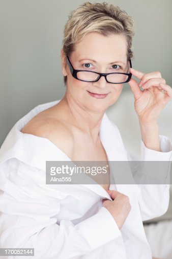 sexy beautiful 50year old woman on a bed stock photo getty images. Black Bedroom Furniture Sets. Home Design Ideas