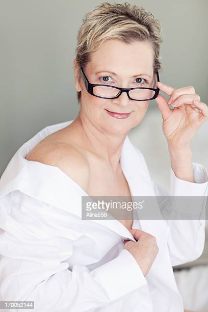 sexy beautiful 50-year old woman on a bed - adults only photos stock photos and pictures