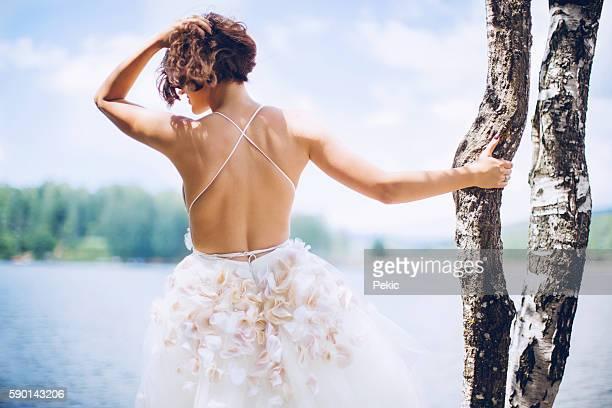 Sexy beautiful bride in her wedding dress