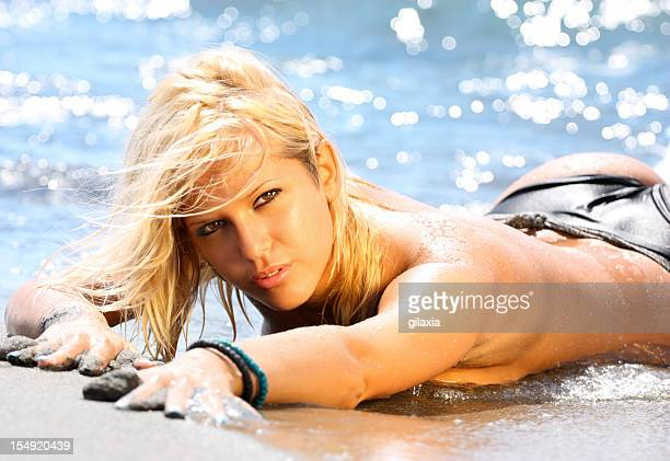 sexy blond at the beach. - topless bikini models stock pictures, royalty-free photos & images