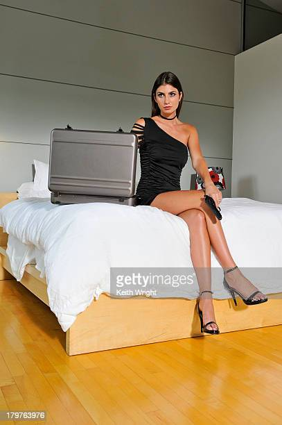 sexy brunette woman with pistol and briefcase. - asymmetric dress stock pictures, royalty-free photos & images