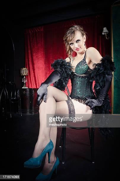 Sexy Burlesque Dancer Posing on a Chair