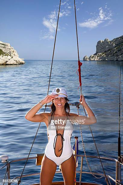 Sexy captain saluting on sailboat