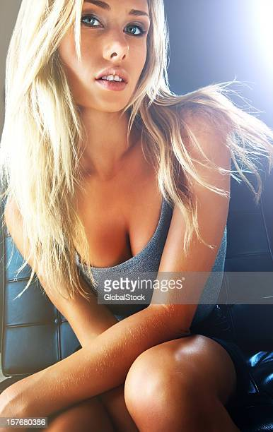 sexy casual woman against a dark background - cute blonde women stock photos and pictures