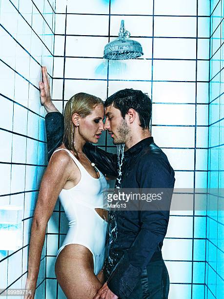 sexy couple kissing in the shower - couples showering stock pictures, royalty-free photos & images
