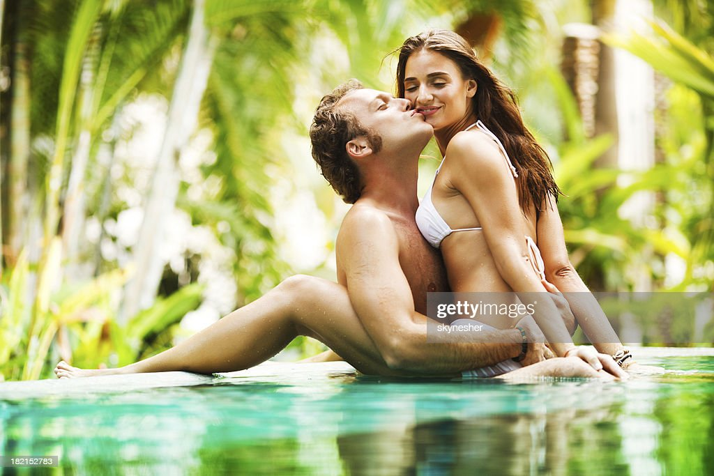 Sexy Couple Showing Affection In The Tropical Pool Stock -7857