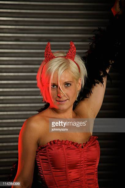 sexy devil... - vintage garter belt stock photos and pictures