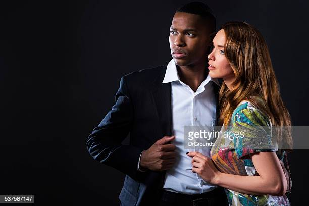 Sexy fashionable couple posing in studio