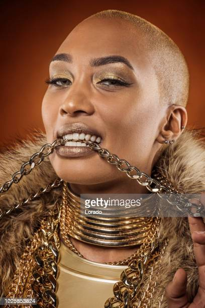 sexy female golden gangster rapper women - gold chain stock pictures, royalty-free photos & images