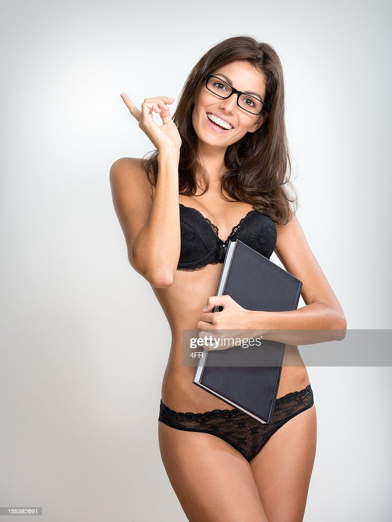 sexy female student teacher with glasses in lingerie stock