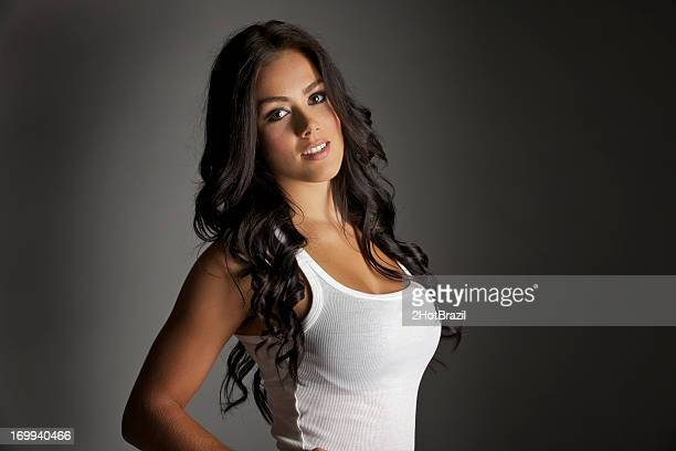 sexy girl in a white tank top - hot babe stockfoto's en -beelden