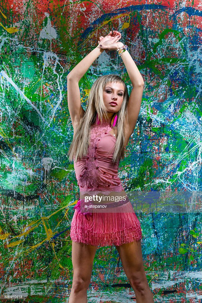 Sexy girl posing of art graffiti : Stock Photo
