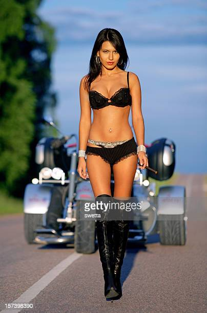 sexy girl with motorbike - motorbike stock photos and pictures