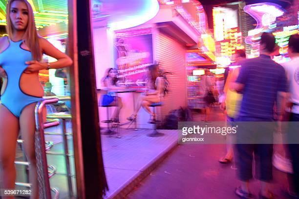sexy girls along soi cowboy, bangkok - thailand prostitutes stock photos and pictures