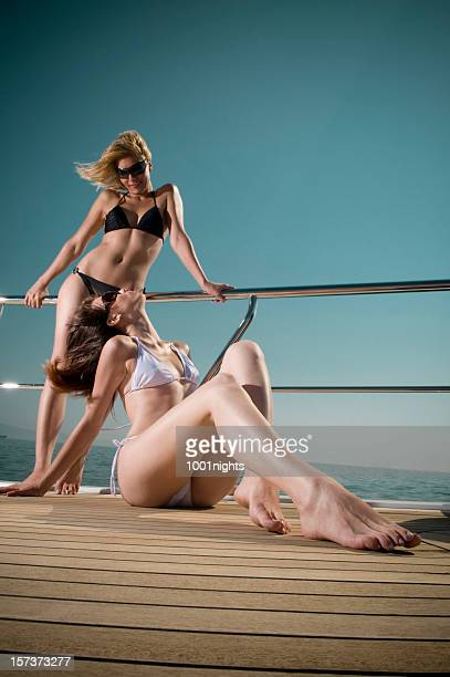 sexy girls on the boat - hot body girls stock photos and pictures