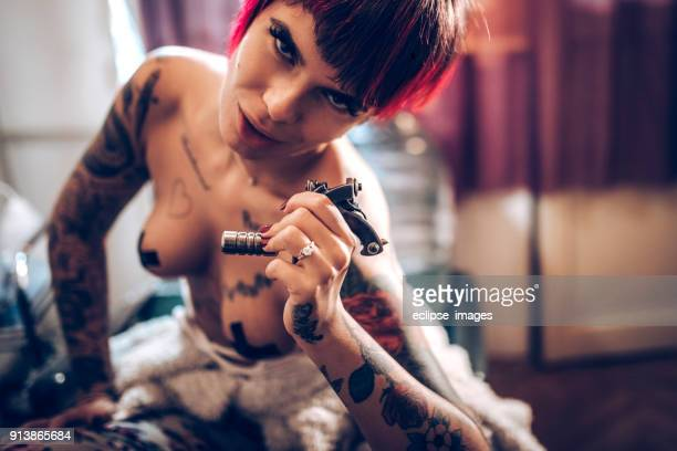 sexy half naked women in tattoo shop - dress shoe stock pictures, royalty-free photos & images