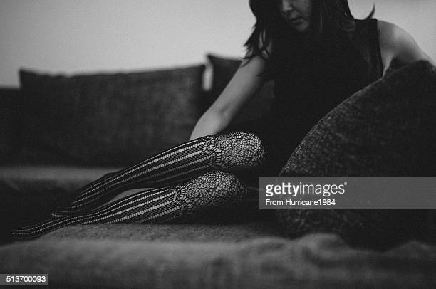 Sexy lady on a sofa