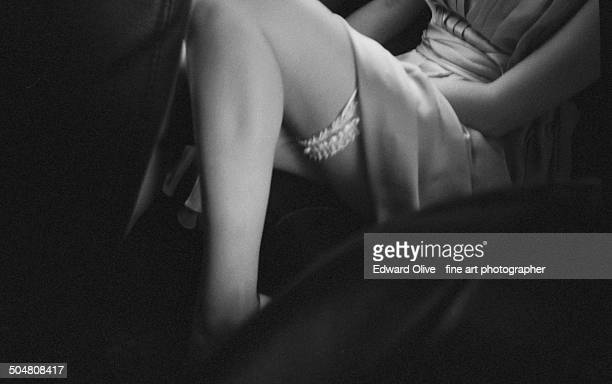 sexy lady wearing a short dress skirt & stockings - focus on background stock pictures, royalty-free photos & images