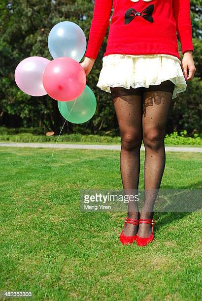 sexy leg of girl and colorful ballons - stocking tops stock photos and pictures