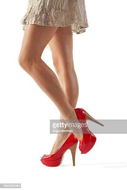 sexy legs and red high heels - leg show stock pictures, royalty-free photos & images