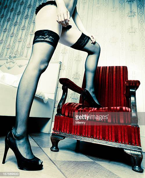 sexy legs, high heels and a red vintage velvet armchair, - seamed stockings stock photos and pictures