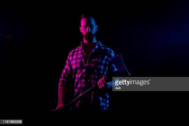 sexy lumberjack in black background with gel lighting - gel effect lighting stock photos and pictures