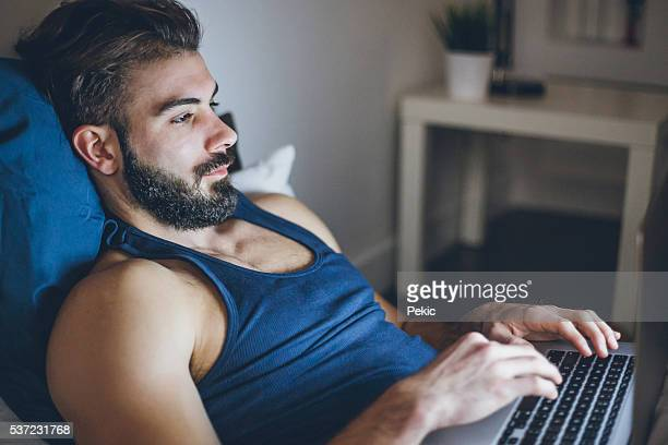 Sexy Man Working on Laptop
