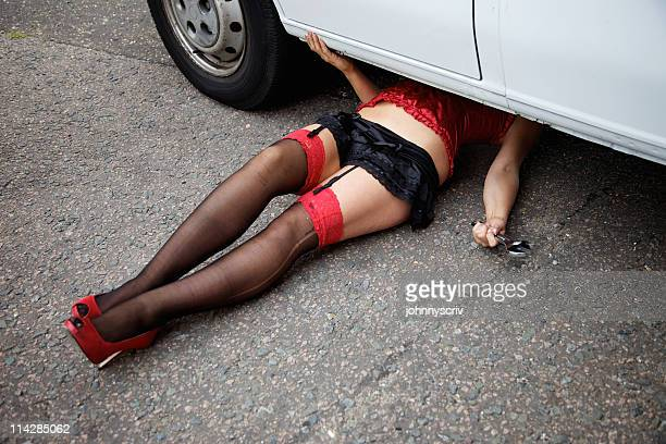 sexy mechanic... - garter belts and stockings stock photos and pictures