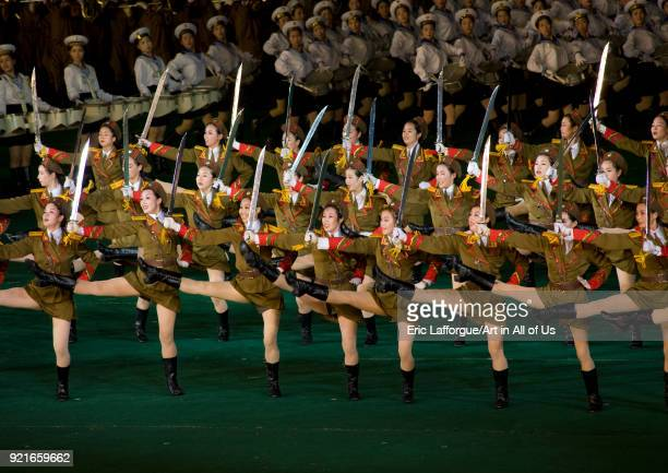 Sexy North Korean women dressed as soldiers dancing with swords during the Arirang mass games in may day stadium Pyongan Province Pyongyang North...