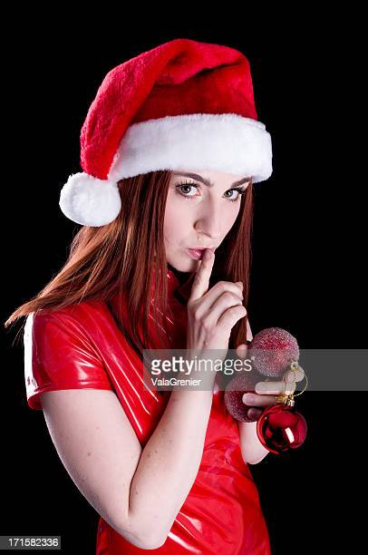 sexy santa's helper mit finger auf den mund legen - fetisch stock-fotos und bilder