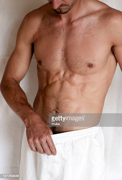 sexy secret - male belly button stock photos and pictures