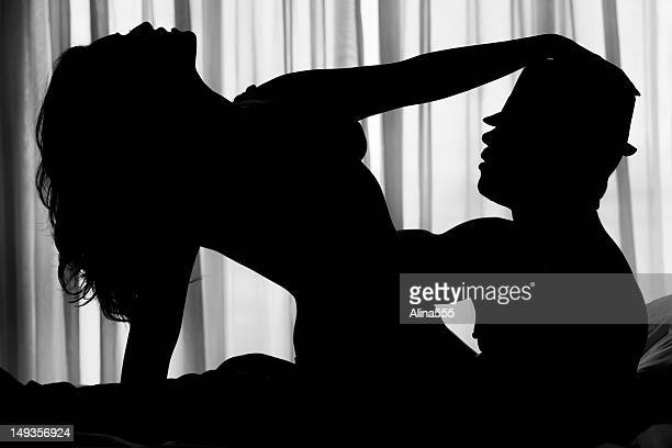sexy silhouette of a couple - image stockfoto's en -beelden