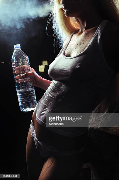 sexy smoking girl in wet shirt - wet t shirts stock pictures, royalty-free photos & images