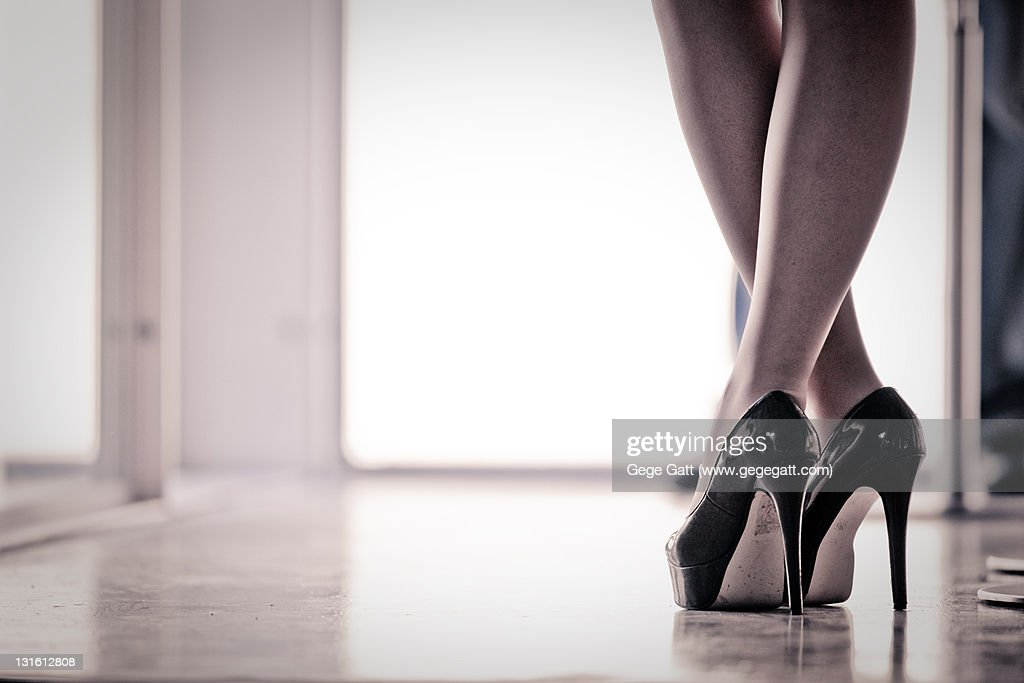 Sexy stiletto heels and crossed legs : Stock Photo