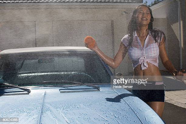 Sexy Teenage Girl Washing Car