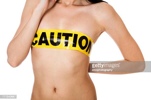 Sexy topless girl with 'Caution' tape