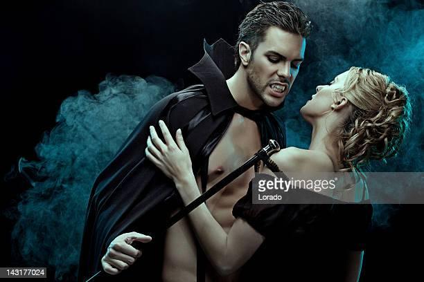 sexy vampire undressing his victim