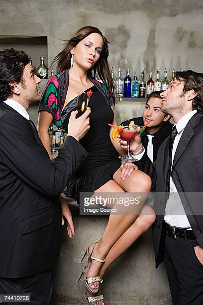 Sexy woman being adored by men