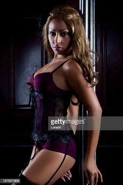 sexy woman dancing striptease - garter belts and stockings stock photos and pictures