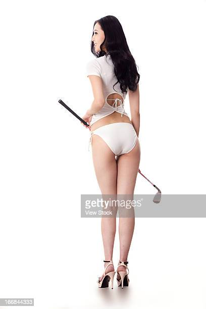 Sexy woman holding golf clubs