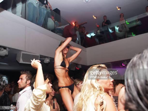 A sexy woman in a bikini dancing on a podium VIP Club Saint Tropez France 2006