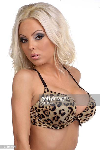 sexy woman in animal print bra - cleavage close up stock photos and pictures